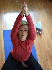 Susan Santoro Martz leading Aroma Flow Yoga.