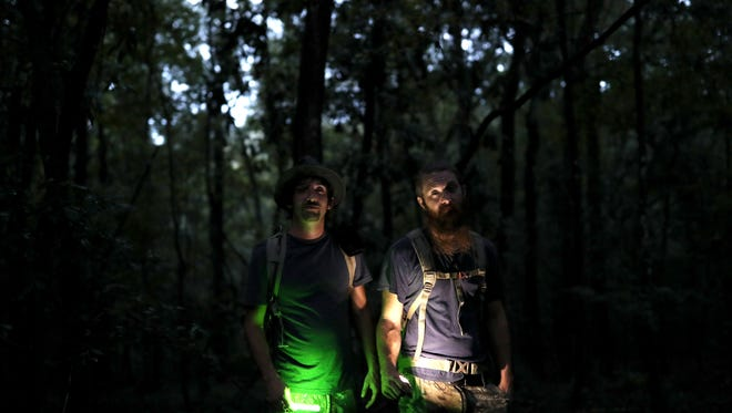 Stacy Brown Jr., right, and Chris Godwin have been camping on the Bridges property for years, hoping to track the sightings of Bigfoot that the family has observed in Chattahoochee, seen here  on Tuesday, Aug. 8, 2017.
