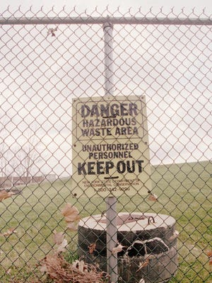 A fence and sign keep people from entering the capped Love Canal dump site.