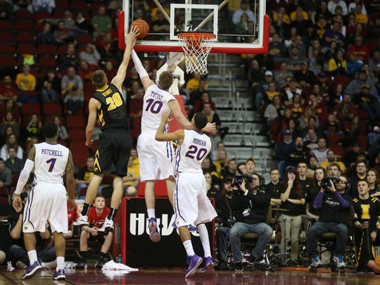 Northern Iowa's Seth Tuttle goes up for a block on Iowa's Jarrod Uthoff during a game in 2014.
