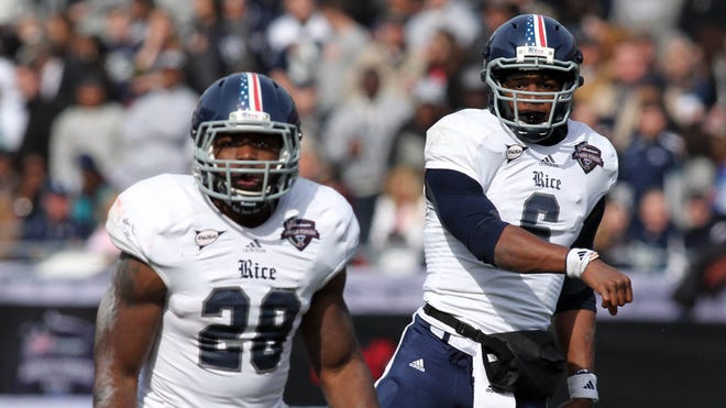 Quarterback Driphus Jackson (6) won't have the luxury of Charles Ross (28) as a teammate this year, but the Owls still can field a potent offense.