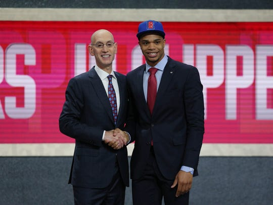 Miles Bridges (Michigan State) greets NBA commissioner