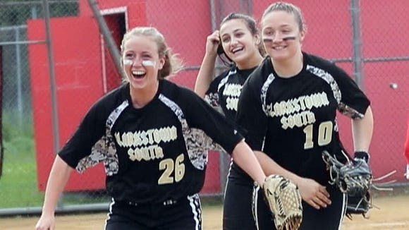 Meghan Keaveney and Tara Hagan celebrate after Clarkstown South defeated North Rockland 3-1 in a Section 1 Class AA first round softball playoff game at North Rockland High School May 18, 2018.