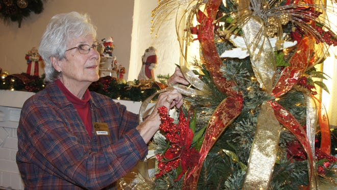 Deming-Luna-Mimbres Museum volunteer Pat Sherman is trimming one of nine Christmas Trees that are now on display at the museum, 301 S. Silver St. the staff is preparing for Sunday's annual Green Tea fundraiser. The event will be from 1:30 to 4 p.m. on Sunday and will feature a festive decorated museum, food, desserts and refreshments.The event is free and open to the public. Donations will be accepted. There will also be a silent auction on vintage merchandise and art work. Local keyboardist Max Crook will provide the entertainment. Stop by and support your Deming-Luna-Mimbres Museum.