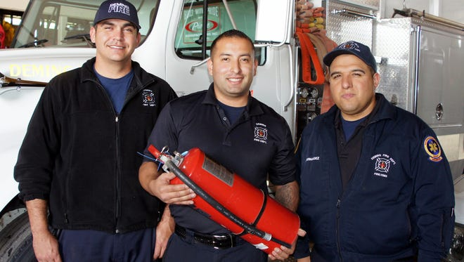 Deming firefighters Julian Hernandez, left, Alex Maynes and Philip Rodriguez are preparing for the holiday season when fire risks are greater.