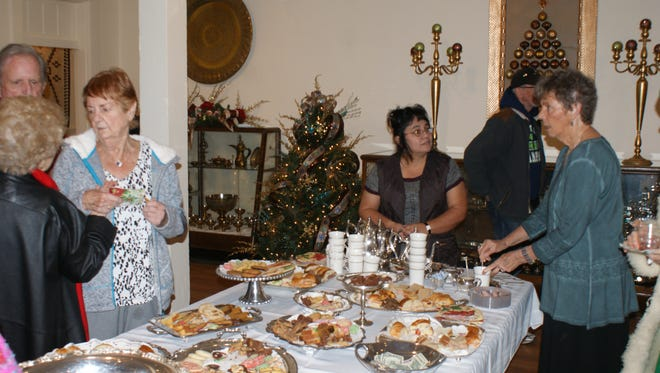 Guests enjoy a large assortment of refreshments during the Deming Luna Mimbres Museum's annual Green Tea fundraiser on Sunday. The event included a silent auction, holiday music and refreshments.