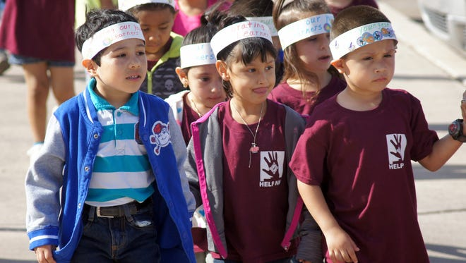 """Children representing the six preschools in Luna County marched through the streets of Deming during the National Day of the Young Child on April 22. These kids wore headbands that read: """"Celebrating our Youngest Learners."""""""