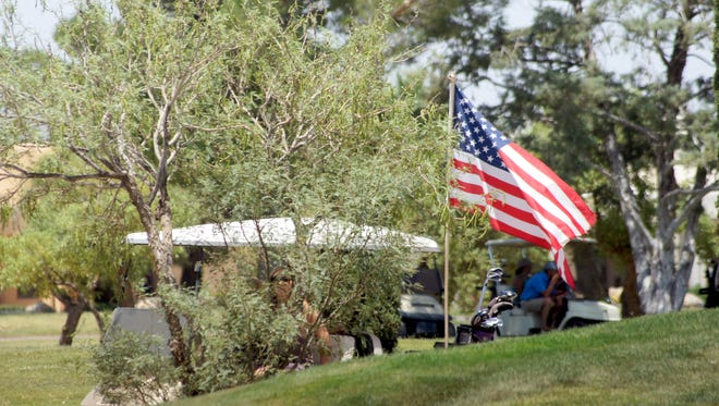 """During the 63rd annual Rio Mimbres Invitational Golf Tournament, a golf cart cart that was following eventual tournament champion Deryk """"Buzz"""" Perales tethered an American flag to its canopy. The cart belongs to Jake Alcorta and the purpose of the flag was to show pride in the nest country in the world. The flag was flown to show support for our troops, and the realization that without them we would not be able to be playing in the greatest golf tournament in New Mexico."""