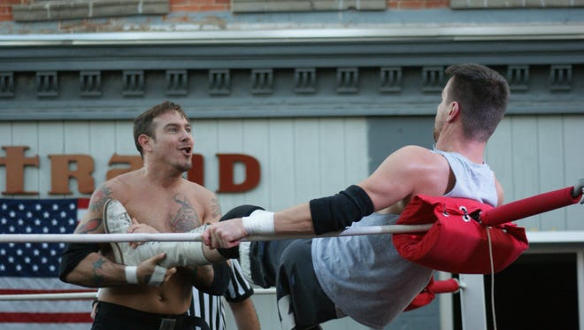 'Amazing' N8 Mattson, left, catches the leg of Zack Gowen during a match at the outdoor 'Fight 4 Fremont' on Front Street downtown.
