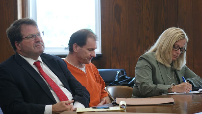 Toledo attorneys Merle Dech and Jane Roman flank Daniel Myers, suspect in the murder of Heather Bogle, in Sandusky County Common Pleas Court during a hearing in July.