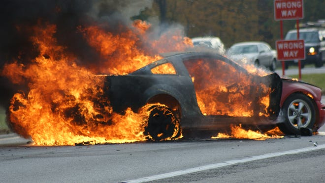 A trooper with Ohio Highway Patrol's Fremont post responded to a crash on U.S. 20 and pulled the driver from the car seconds before it burst into flames.