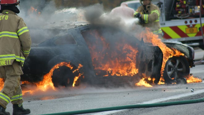 The driver of this Mustang was rescued from the crashed car seconds before it became fully engulfed in flames.