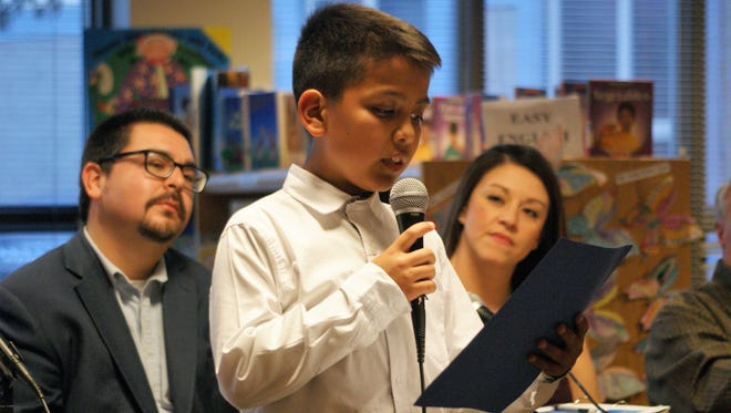 Jose Carreon, center, addressed the school board as President of the Columbus Elementary student council. Behind him, from left, are President Matt Robinson and Sophia Cruz.