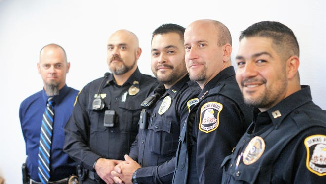"""The Deming Police Department has been grooming facial hair for """"No Shave November."""" Officers contributed $30 for the privilege of growing beards and used the pool of money to purchase turkeys which will be distributed to needy families on Wednesday, Nov. 22, the day before Thanksgiving. The officers report mixed reviews of their beards from spouses and significant others, although one spouse was firmly in the """"keep the beard"""" camp. She will have to take that up with the Chief. From left, Captain Clint Hogan, Detective Sgt. Conrad Jacquez, Lt. Lou Tavizon, Chief Bobby Orosco, and Capt. Alex Valdespino."""