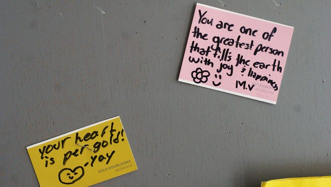 """Many of the classroom doors at Deming Intermediate School sport affirmations left by students and staff on sticky notes, a practice encouraged by the """"Capturing Kids' Hearts"""" program."""