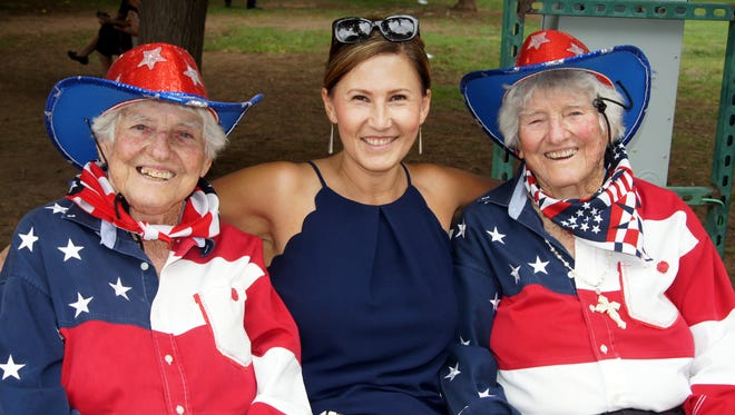 Susie Mendez, center, spent some time with Fourth of July celebration fixtures Gertrude, right, and Geraldine Kretek back in 2018.