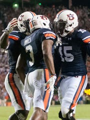 Auburn defensive back Jonathan Jones celebrates with Joshua Holsey after intercepting the ball in the end zone against South Carolina.