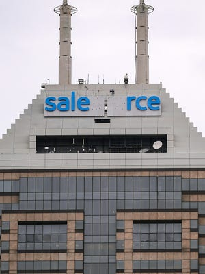 Salesforce lettering is seen mid-completion, replacing the old Chase logo at 1 East Ohio Street, downtown Indianapolis, Thursday, April 20, 2017.