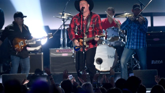 Milestone honoree Garth Brooks performs at the 50th annual Academy of Country Music Awards at AT&T Stadium on Sunday, April 19, 2015, in Arlington, Texas. (Photo by Chris Pizzello/Invision/AP)