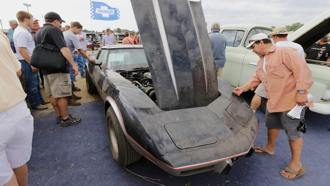 A 1978 Chevrolet Indy Corvette Pace Car is looked over during a preview for an auction of vintage cars and trucks from the former Lambrecht Chevrolet dealership in Pierce, Neb.