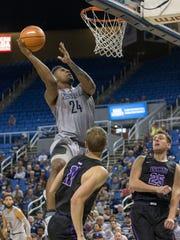 Nevada's Jordan Caroline lays the ball up against Grand