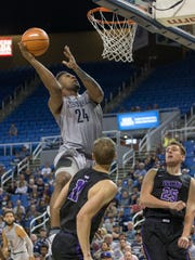 Nevada's Jordan Caroline lays the ball up against Grand Canyon in their basketball game at Lawlor Events Center in Reno, Nevada on Sunday, Oct. 22, 2017.
