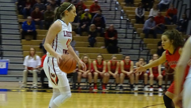 Liberty Union's Gabby Burris scored 32 points and grabbed 15 rebounds to help lead the Lions to a 58-45 win over Pleasant in the Division III Central district championship game on Friday.