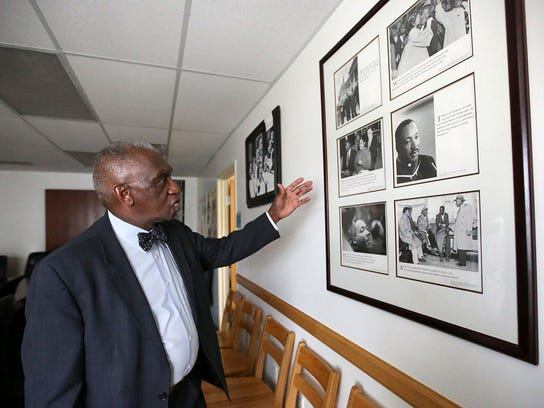 Pastor France A. Davis shows a collage of photos of Rev. Dr. Martin Luther King Jr. hanging at Calvary Baptist Church in Salt Lake City on Wednesday, March 28, 2018. Davis knew Rev. Martin Luther King Jr. and draws inspiration from his work.