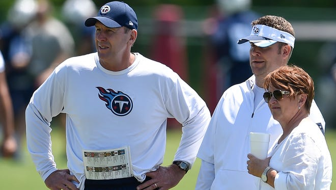 Titans coach Mike Mularkey, general manager Jon Robinson and controlling owner Amy Adams Strunk watch practice in May at St. Thomas Sports Park.