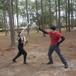 Desso Faulkner practices with a lightsaber during a training session at Hitzman Optimist Park.