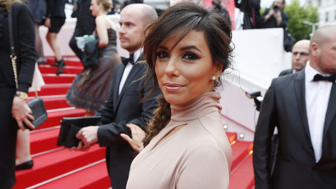 """Eva Longoria poses as she arrives for the screening of the film """"Foxcatcher"""" at the 67th edition of the Cannes Film Festival in Cannes, southern France, on May 19, 2014."""