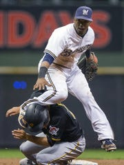 Milwaukee Brewers' Jean Segura gets the force out at