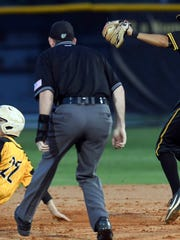 Kyle Jackson of Merritt Island slides into a base during last year's regional baseball final.