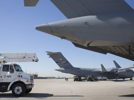 An APS bucket truck is loaded into a C-17 at the Sky
