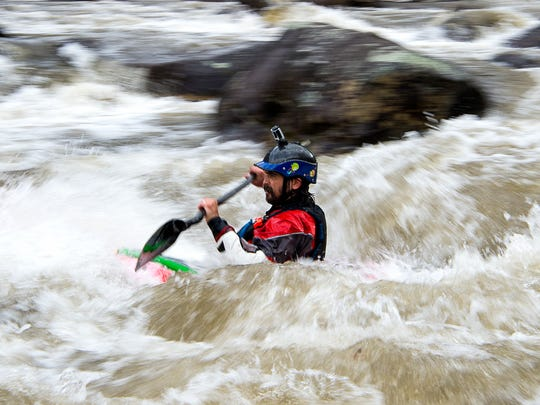 A kayaker takes on a series of large rapids March 25, 2017  on the Cheoah River.