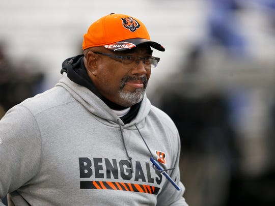 Cincinnati Bengals tight ends coach Jonathan Hayes takes the field before the first quarter of the NFL Week 17 game between the Baltimore Ravens and the Cincinnati Bengals at M&T Bank Stadium in Baltimore on Sunday, Dec. 31, 2017. At halftime the Bengals led 17-10.