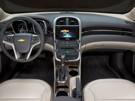 The 2014 Chevrolet Malibu'??s redesigned center console has a longer armrest, providing greater comfort, storage space for two cellphones and a pair of cup holders.