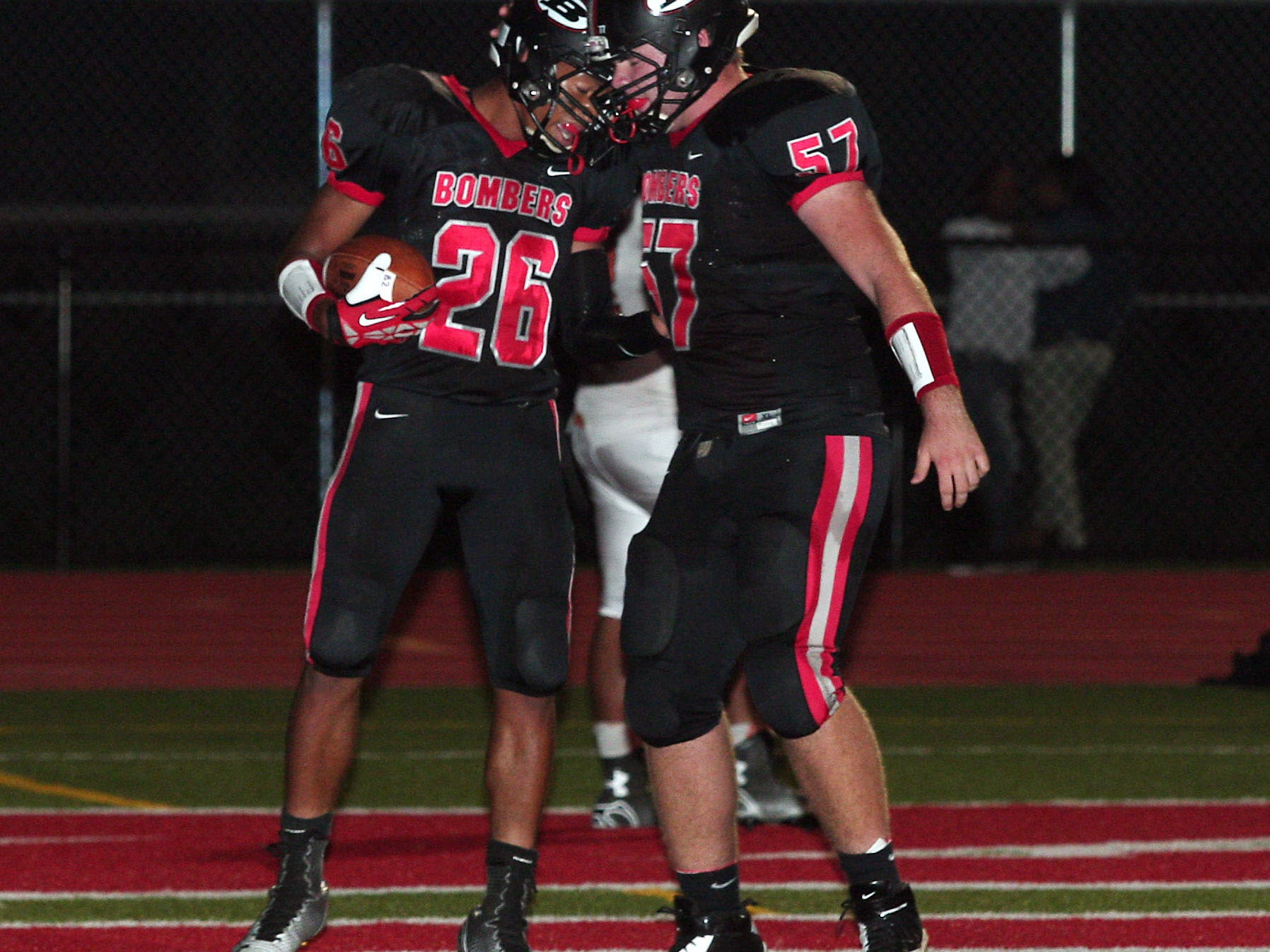 Boonton running back Josh Smith celebrates with teammate Connor Davis after Smith's first half touchdown against Dover on Sept. 26.
