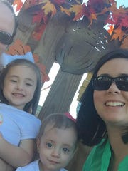 Staci Teadt (right) of Carencro said she and husband Matthew (left) spend more than $900 for child care for their two girls, Collins, 4, and Adelynn, 1.