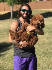"Josh the Goldendoodle with his ""dad"" Andrew Hangartner."