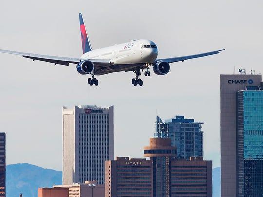 A Delta Airlines jet lands at Sky Harbor International