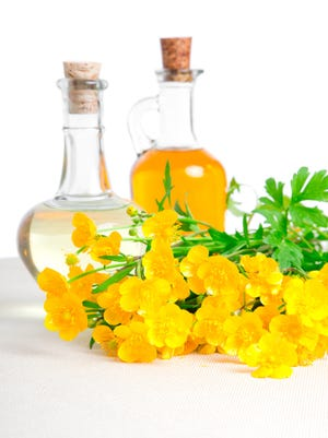 bottle of oil with flower