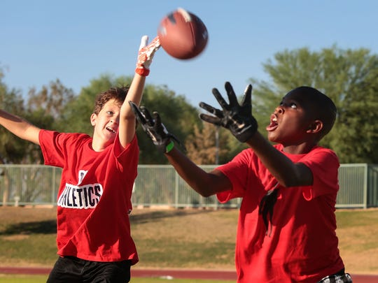 Jarvis Crawford, right, 12, and Calvin Miller, 11,