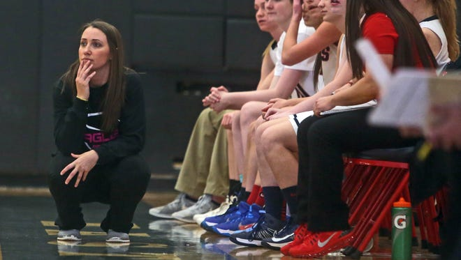 Eastchester girls basketball coach Lindsay Carr watches her team play against Rye at Eastchester High School School Jan. 8, 2015. Rye defeated Eastchester 59-50. This is Carr's first year as Eastchester head coach.