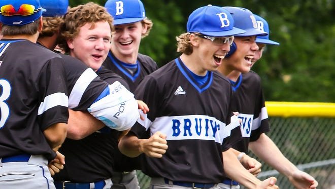 Brentwood's Mason Keidel (hat off) celebrates with teammates after his walk-off grand slam against Blackman.