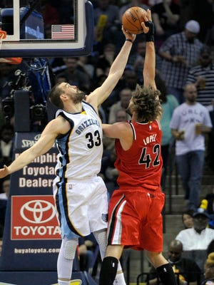 Memphis Grizzlies center Marc Gasol (33) blocks the shot of Portland Trail Blazers center Robin Lopez (42) during the game at FedExForum.