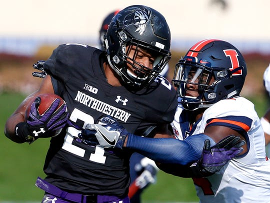 Northwestern running back Justin Jackson is tackled