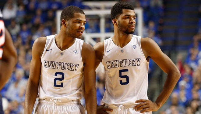 Aaron Harrison, left, and  Andrew Harrison missed seven of eight shots down the stretch in the national semifinal game vs. Wisconsin.