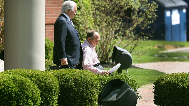 Robert Morgan and his attorney John Speranza leave Morgan's office on Pittsford-Victor Road in Perinton, as federal agents were collecting items inside the building on Monday, May 14, 2018. Morgan is CEO of Morgan Management LLC, which handles many projects in the Rochester and Buffalo markets.