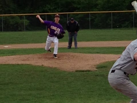 Sending a pitch during Tuesday's game is Plymouth Christian's Adam Albert.